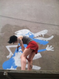 Margot Bird working on her mural at Appalach-Wick